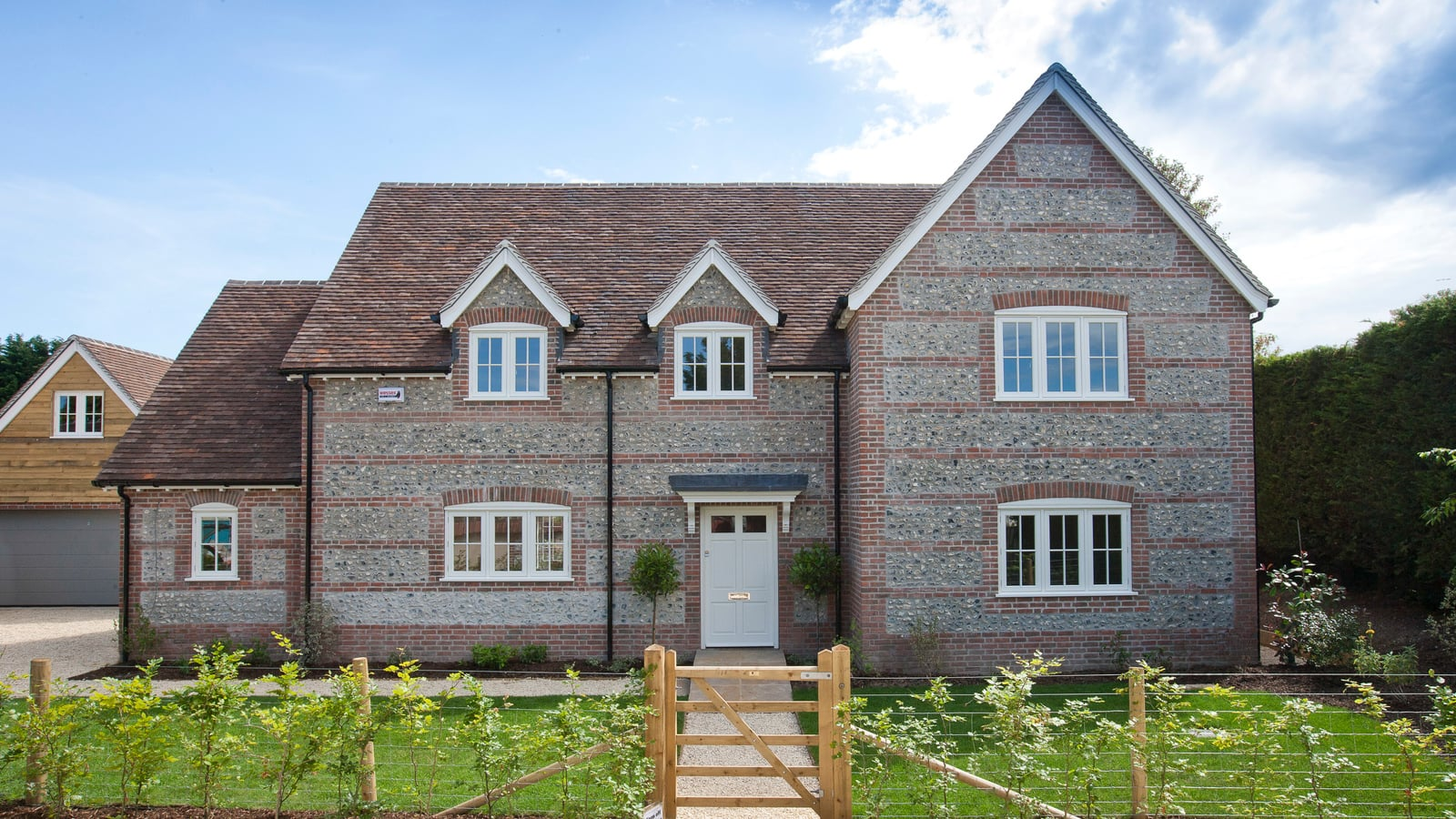 Cottage style new build property with casement windows and French Doors
