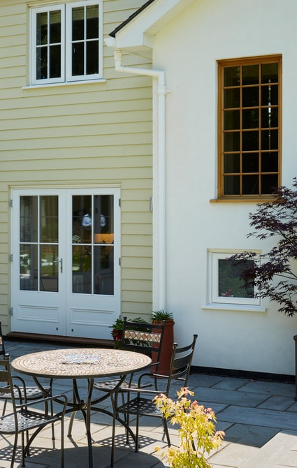 Casement windows above french doors