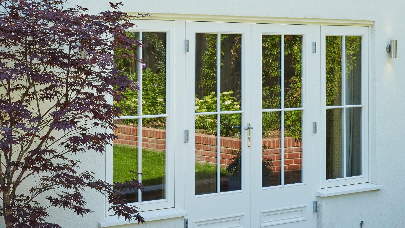 Casement windows aside french doors
