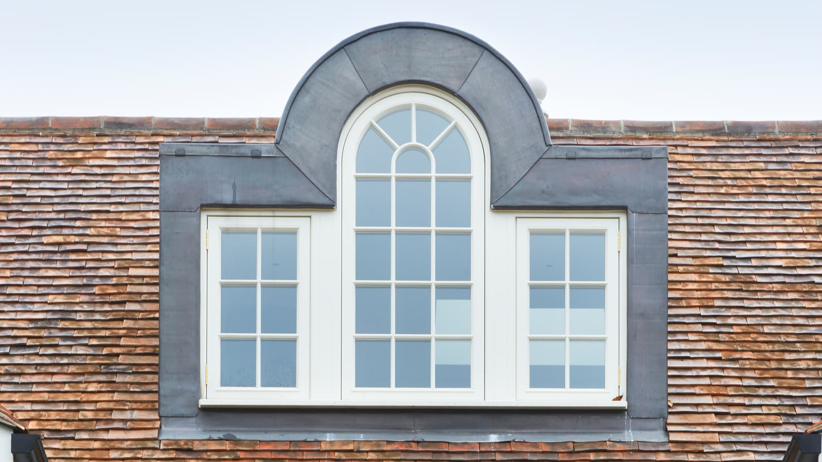 Central shaped feature casement window on the second floor