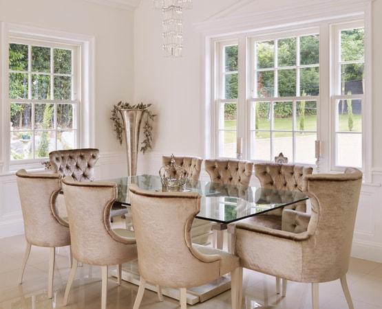 Dining area with standard spring balanced sash windows painted Westbury White