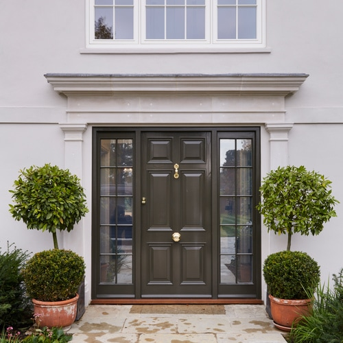 Entrance door with intelligent switchable glass units that change from satin to clear