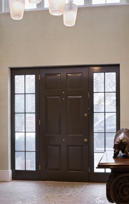 Entrance door that incorporates special raised & fielded panels with bolection mould