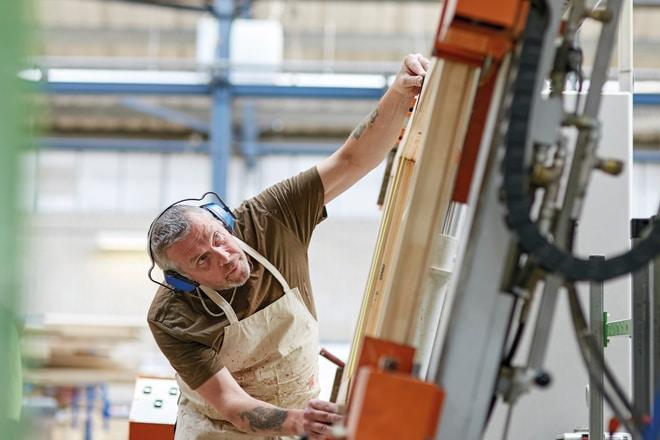 Factory worker using glue machine