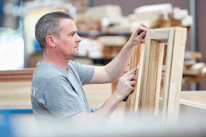 Factory worker and window frame