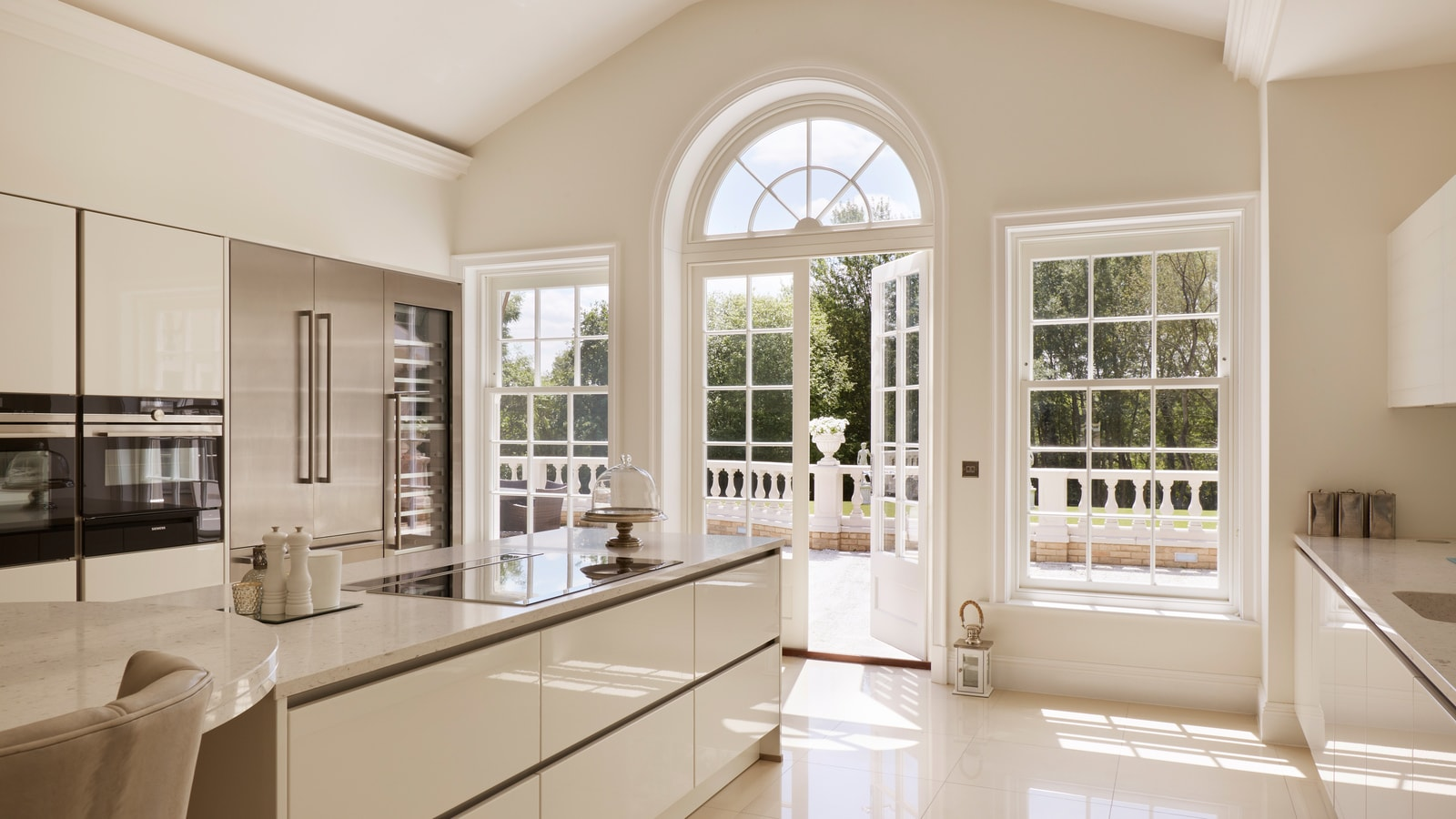 Kitchen area with mixture of French doors & sash windows
