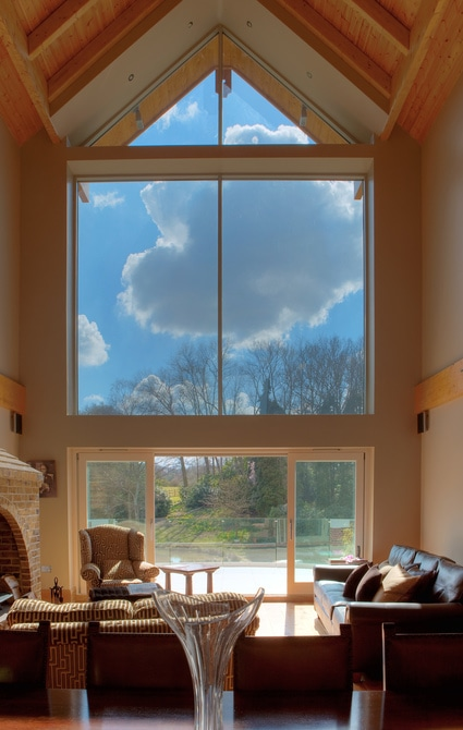 Large fixed glazed gable window in sitting room