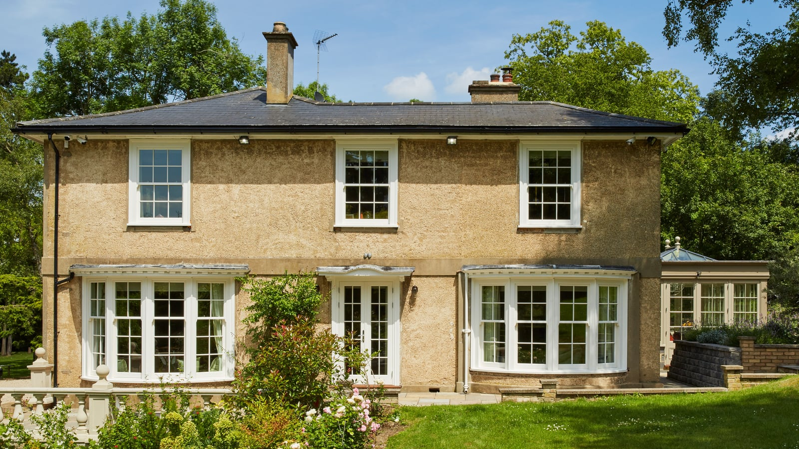 Legacy box sash windows with solar reflective glazing and bay windows