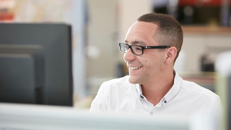 Male Westbury staff member on computer