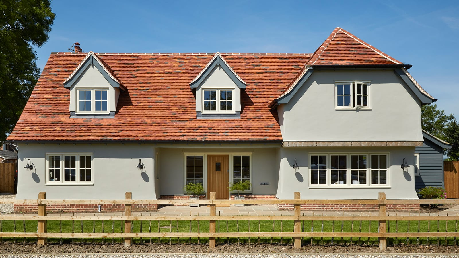 New build house with timber windows painted in Westbury Birch