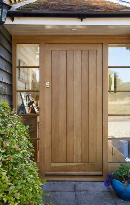 Panelled oak front door with glazed sidelights