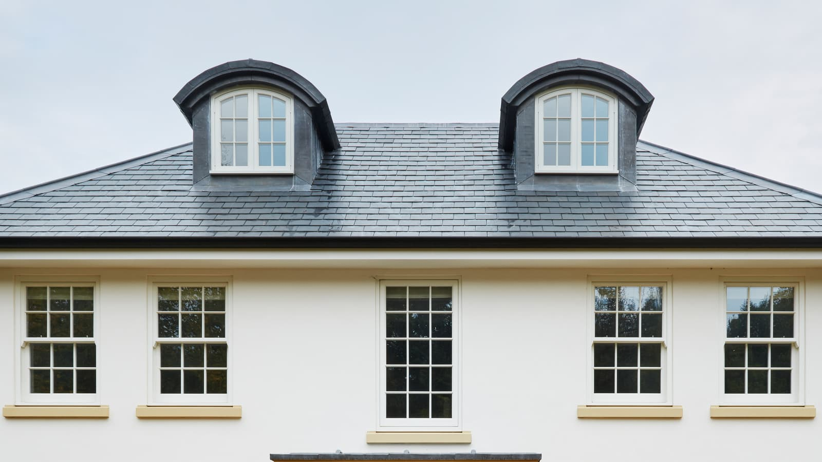 Shaped French dormer windows