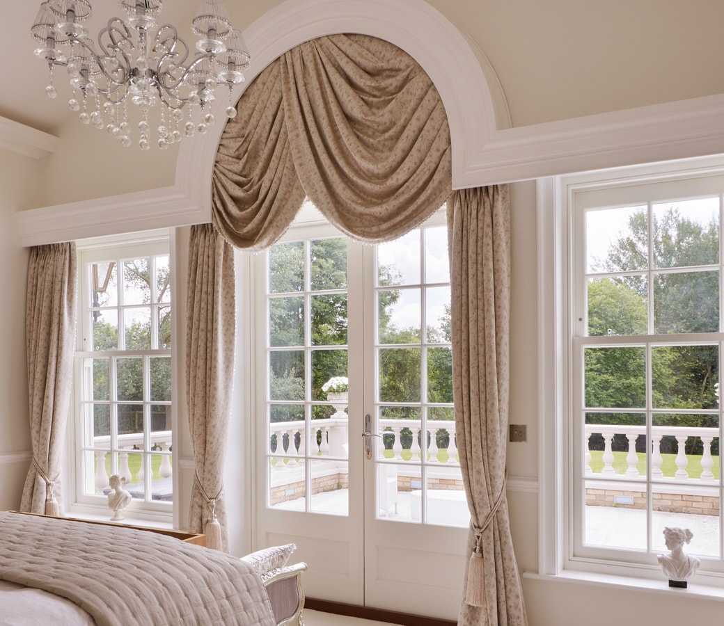 Symmetrical pair of Venetian styled triple sash windows and French Doors