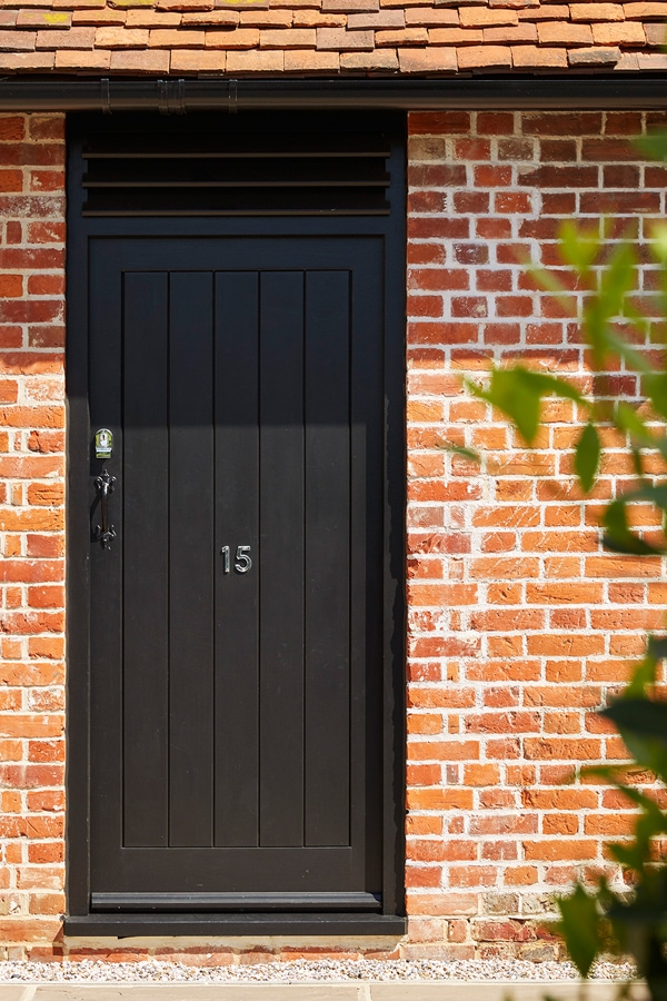 Boarded entrance door painted Westbury Black