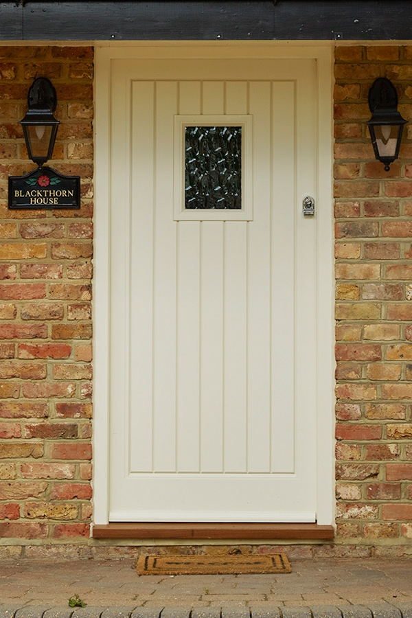 Boarded entrance door painted Westbury White
