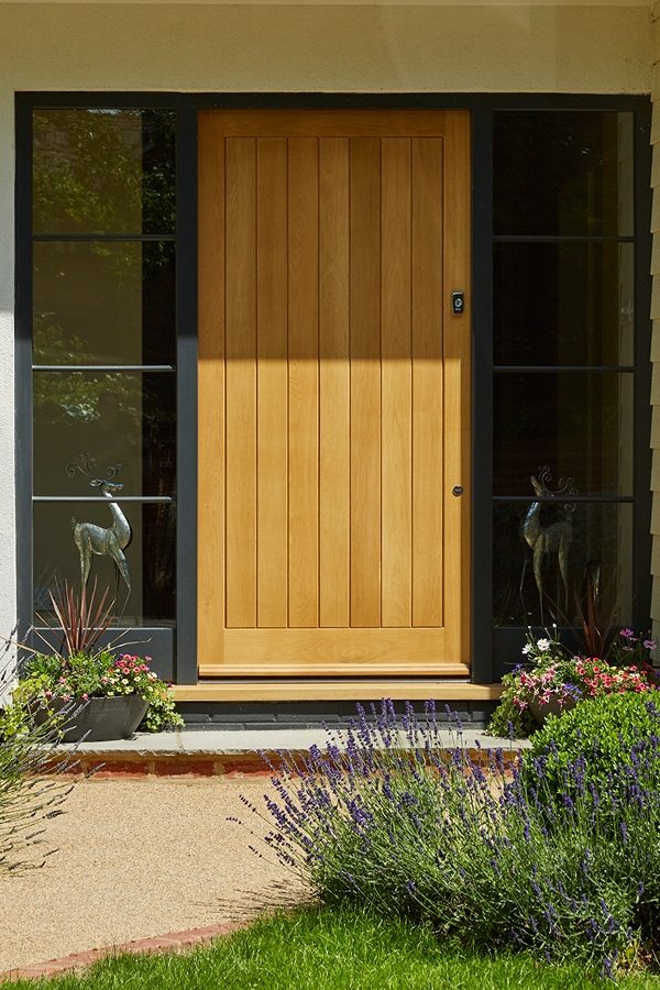 Boarded front door with sidelights