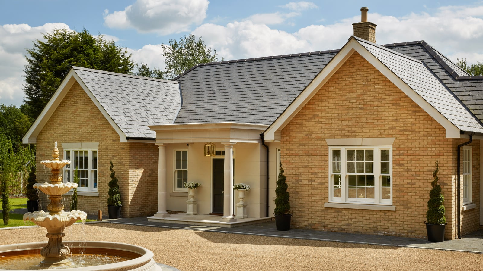 Front of beautiful new build bungalow with Spring sash windows