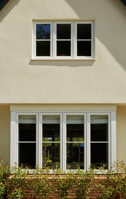 New build house with cottage style casement windows