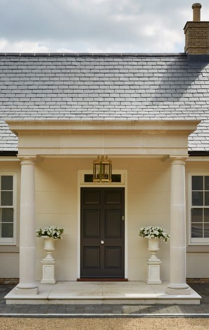Classic 6- panel entrance door painted in Westbury Black