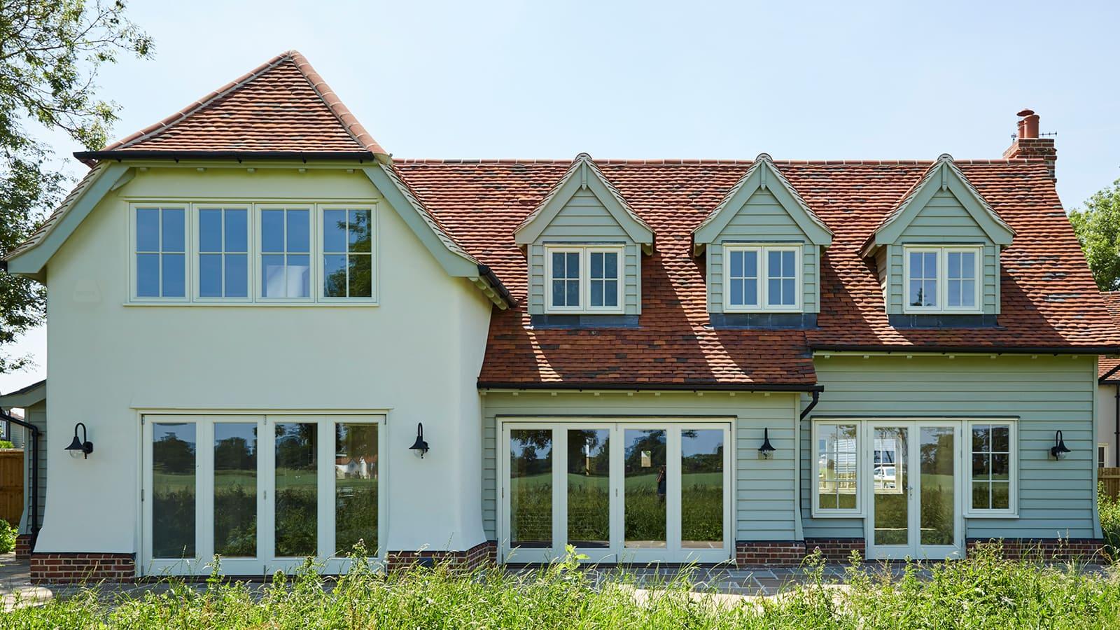 New build fully glazed casement windows and glazed sliding doors