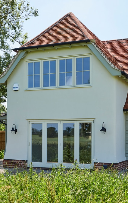 Rear of house with casement windows and glazed sliding doors