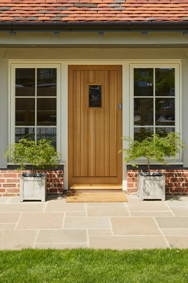 Oak boarded front door with sidelights