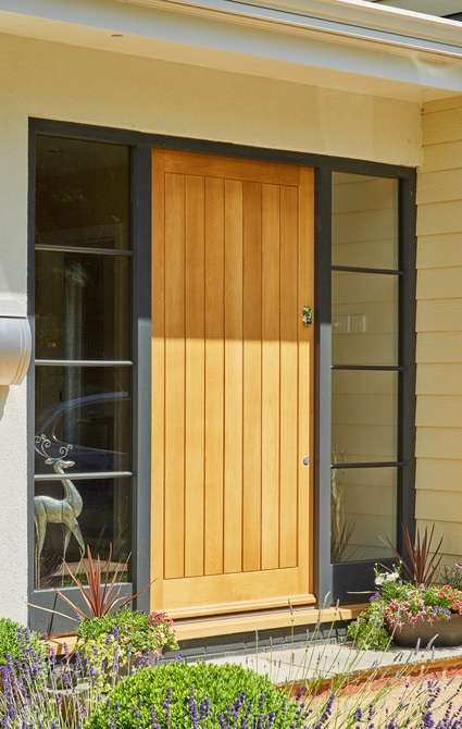 Oak front door with grey painted sidelights