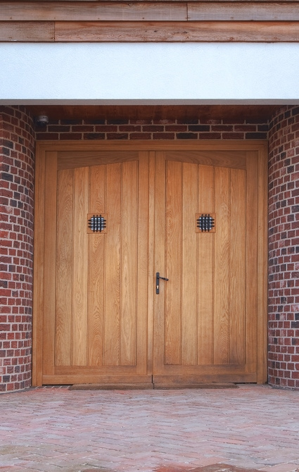 Large oak stained double doors create an impressive entrance