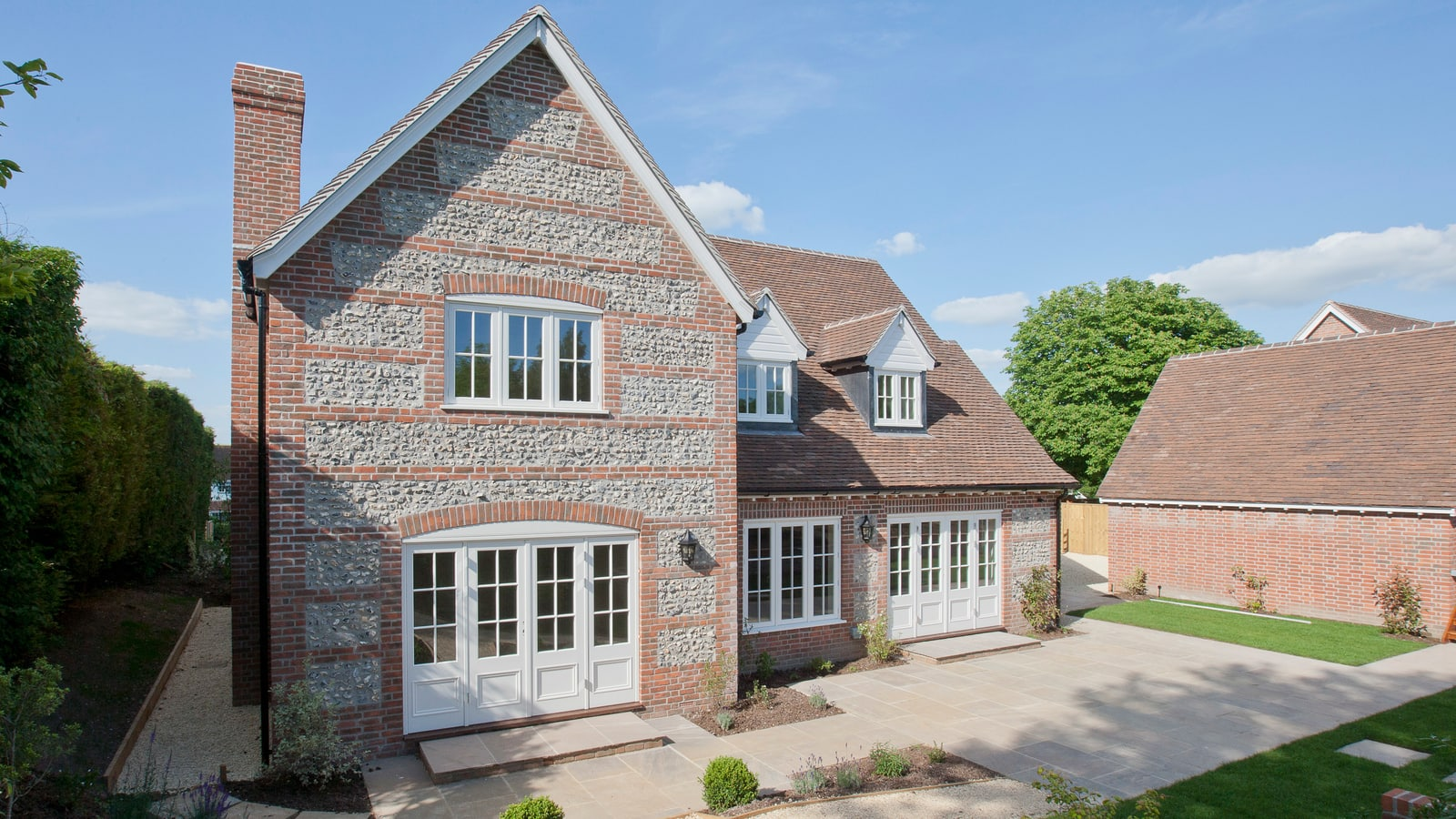 Rear of property with casement windows and French doors