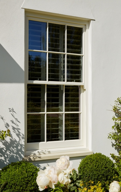Spring-balanced, sliding sash windows