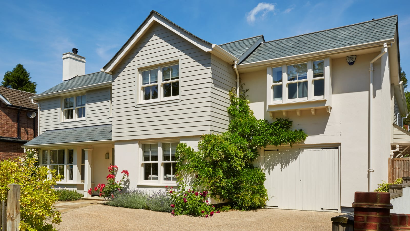 Property with standard spring balanced sash windows and part panelled (bolection) entrance door