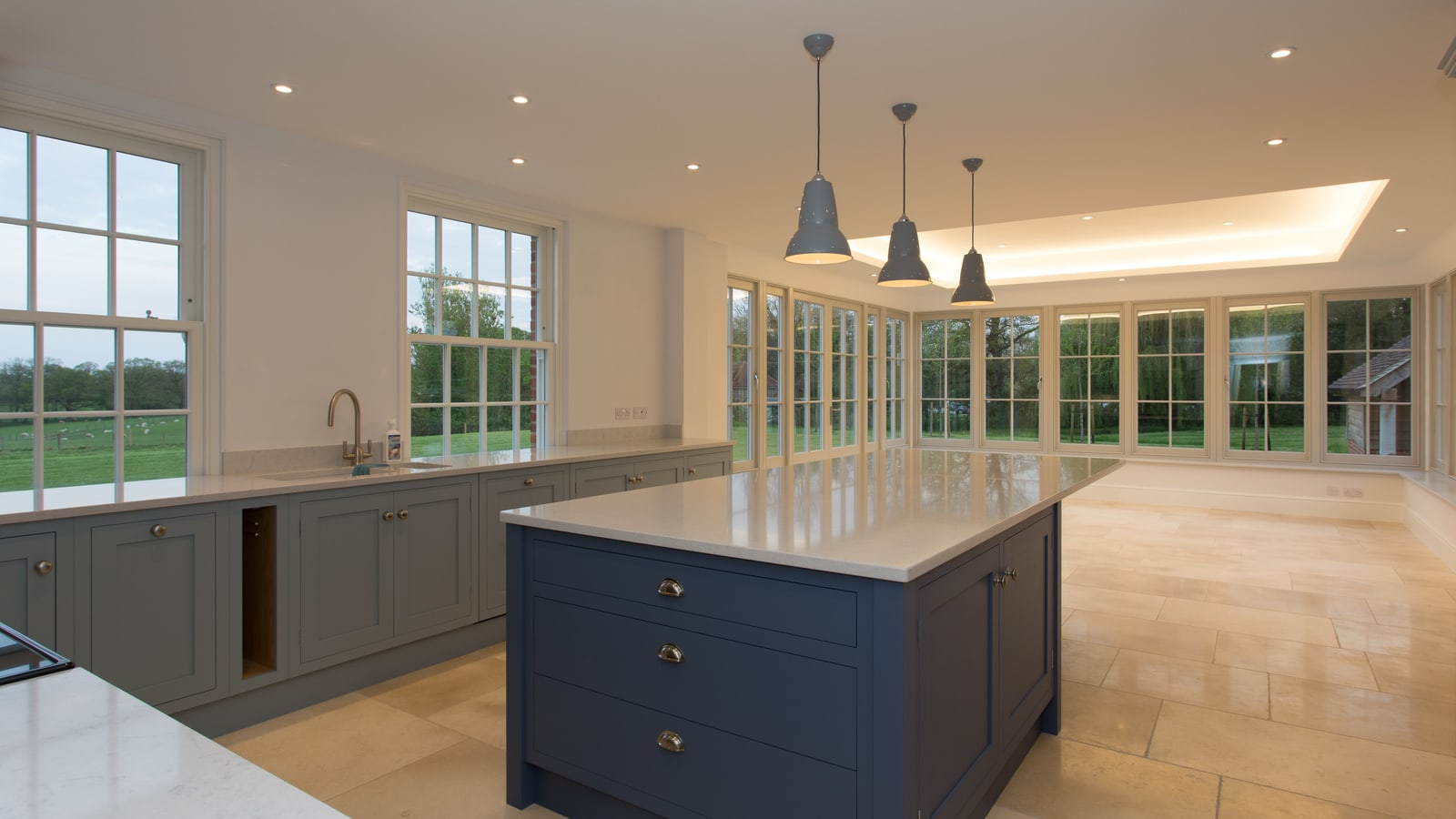 Garden room extension adds a luxurious open plan kitchen space flooded with natural daylight from the timber windows