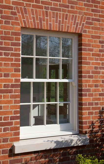 Spring balanced timber windows sit behind the brickwork on stooled stone cills