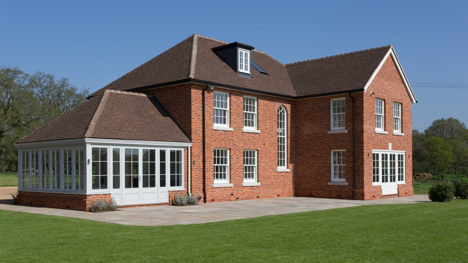 The timber windows and doors are finished in a Westbury White paint finish