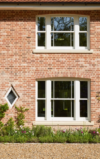 Westbury weighted box sash windows with margin glazing design, sat in recessed reveals