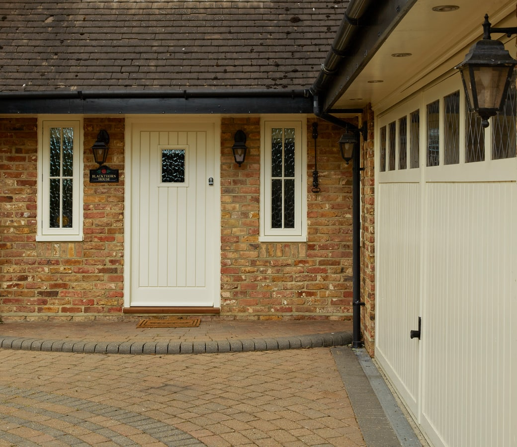 Casement windows and doors installation - entrance door with side windows