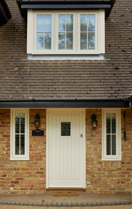 Casement windows and doors installation - V-groove boarded entrance door with vision panel