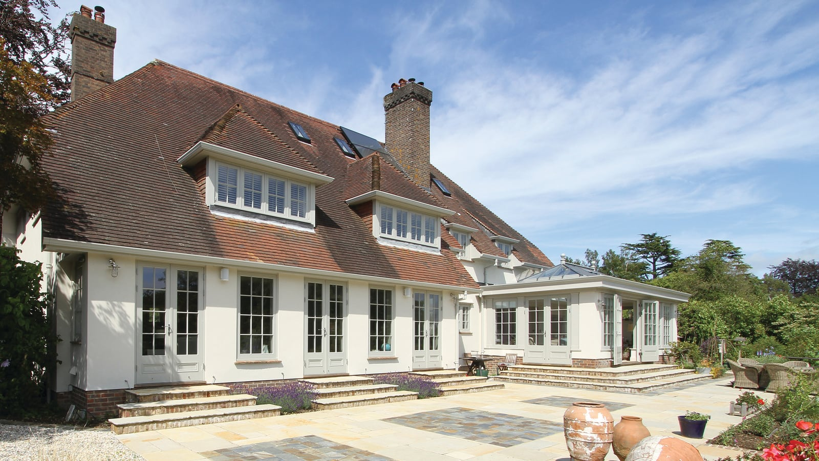 Large full-length casement windows with French doors to compliment the rear of the house