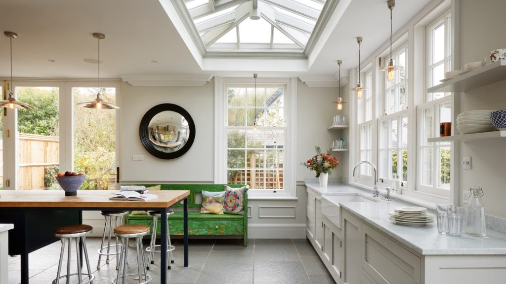 Timber French doors and roof lantern encourage light to flood in and fill this stunning kitchen family room