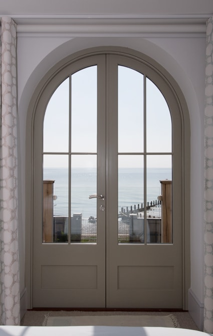 French doors with curved tops