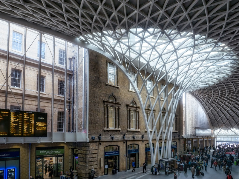 Designed to hold huge numbers of people flowing from platform to platform, the spectacular glazed roof at Kings Cross Station lets in plenty of light into the space below, with steel 'stalks' spreading out like the branches of a tree.
