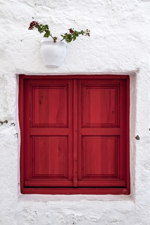 Traditional red wooden window shutters in Bodrum, Turkey