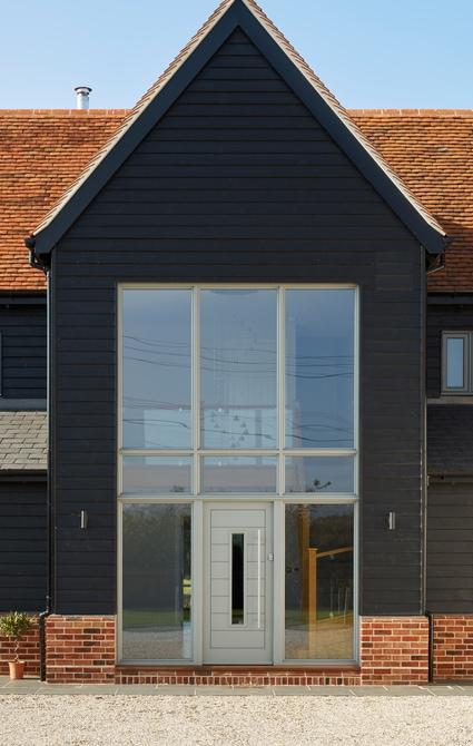 entrance door itself is a contemporary, horizontally-boarded door made from Accoya