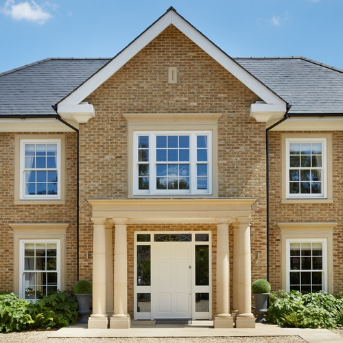 Modern new build with traditional box sash windows
