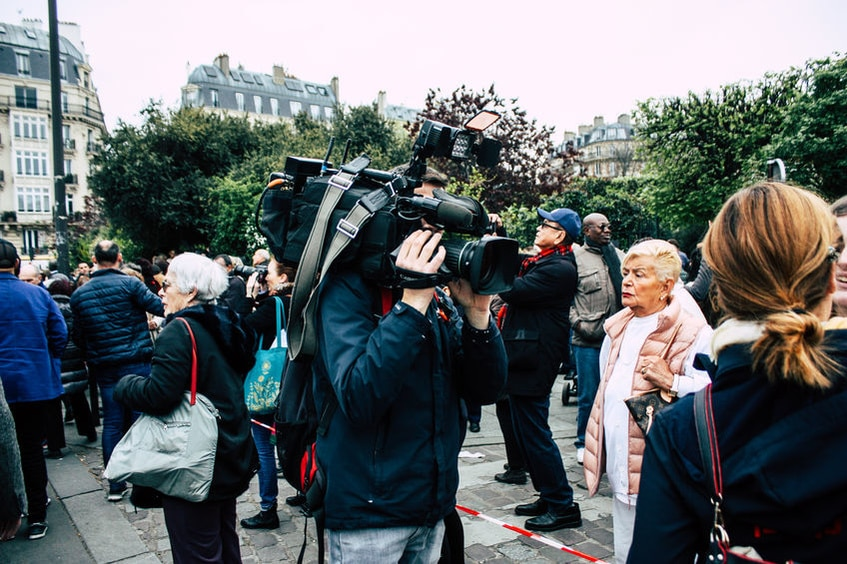 Paris France April 16, 2019 View of a journalist interviewing Parisians about the Notre Dame cathedral which burned the day before in a big fire