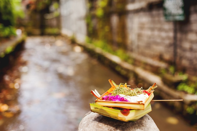 Traditional offerings to the gods. Common religious tradition in the Buddhist and hinduistic countries in Asia. Bali, Indonesia.