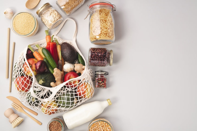 Zero waste concept. Eco bags with fruits and vegetables, glass jars with beans, lentils, pasta. Eco-friendly shopping, flat lay