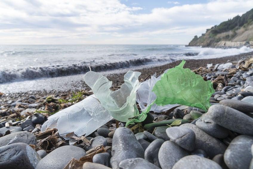 Plastic bottles on a pebble beach