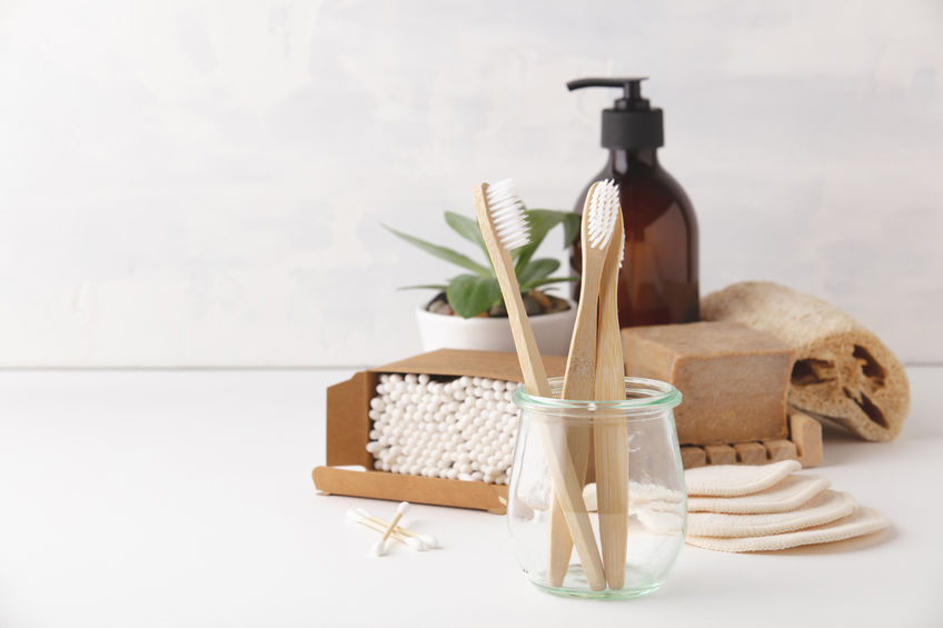 Zero waste, Recycling, Sustainable lifestyle concept. Eco-friendly bathroom accessories: toothbrushes, reusable cotton make up removal pads, make up remover in a glass container, natural brushes, handmade soap, bamboo ear sticks