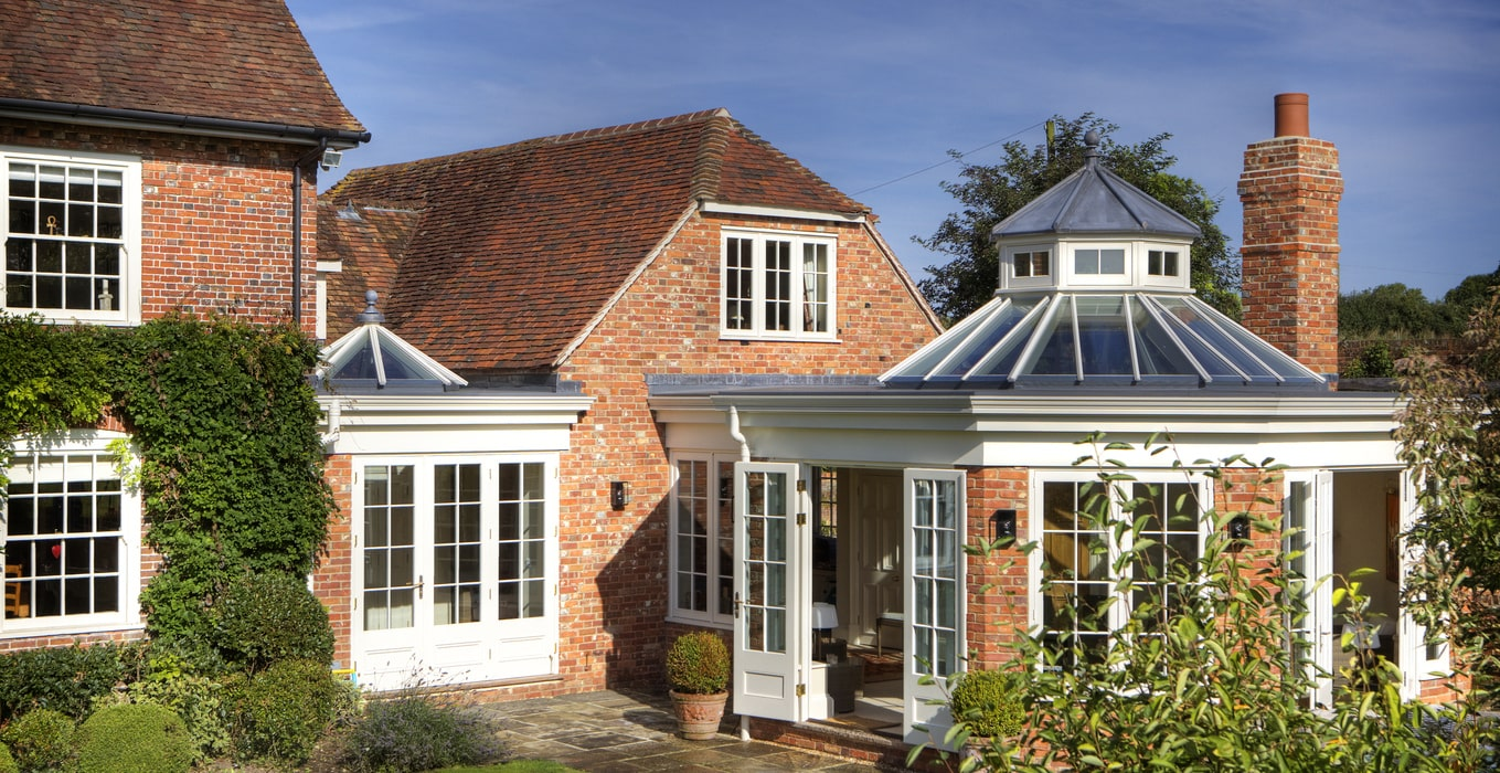 What are the benefits of a glass roof in an extension?